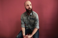 WF - Denim Shirt With Rolled Sleeves Stitting On Stool Against A Red Wall - Photo Credit Shervin Lainez - High Res